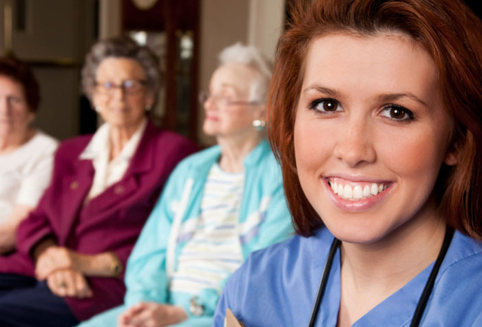 Medical assistant smiling with patients.