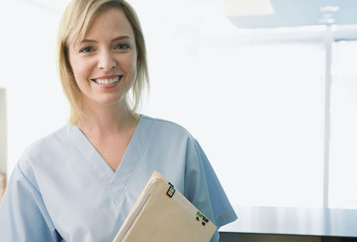 Medical assistant holding a file