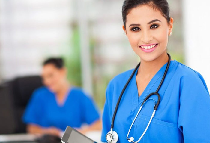 Medical assistant in an office setting for Why Become a Medical Assistant