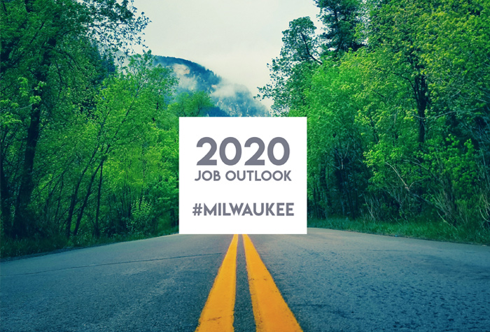 2020 Job Outlook sign on a deserted road in the mountain wilderness.