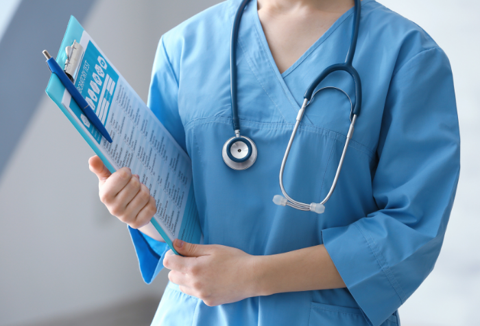 medical assistant holding a clipboard